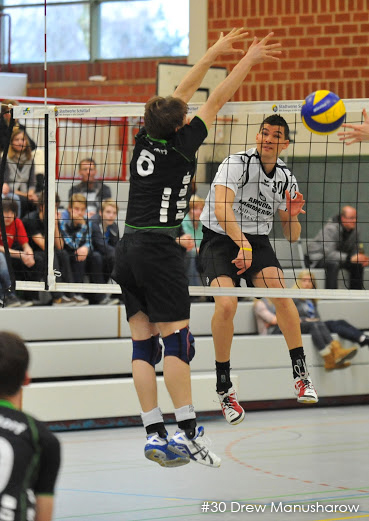 #30 Drew Manusharow hits volleyball ball past Lintorf blockers