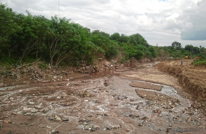 filthy city run off and waste filled river