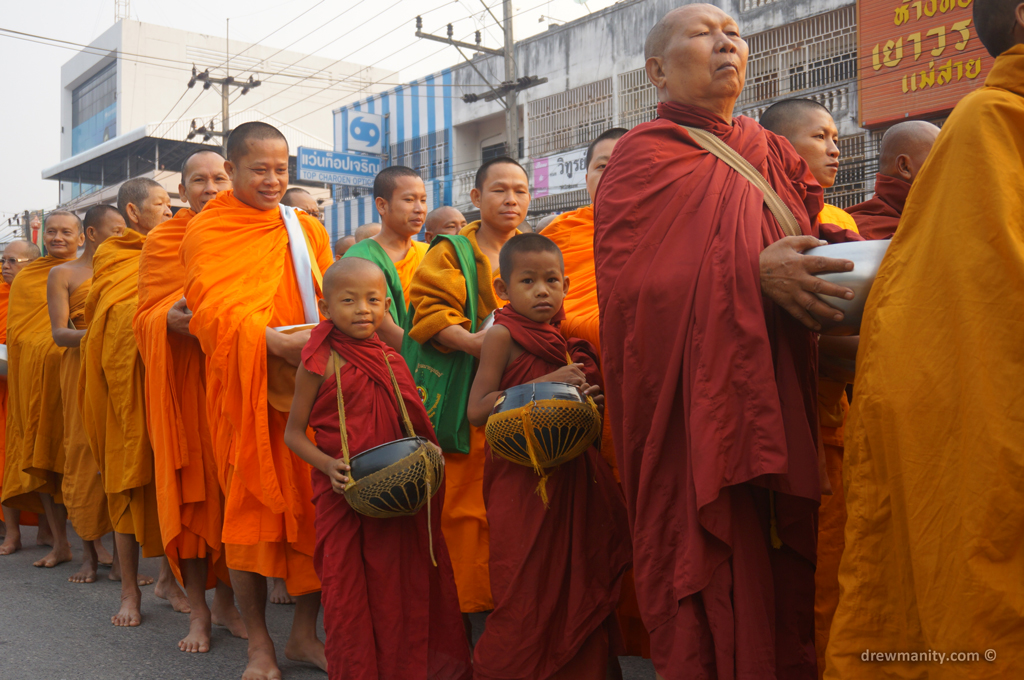 monks waiting in like for alms