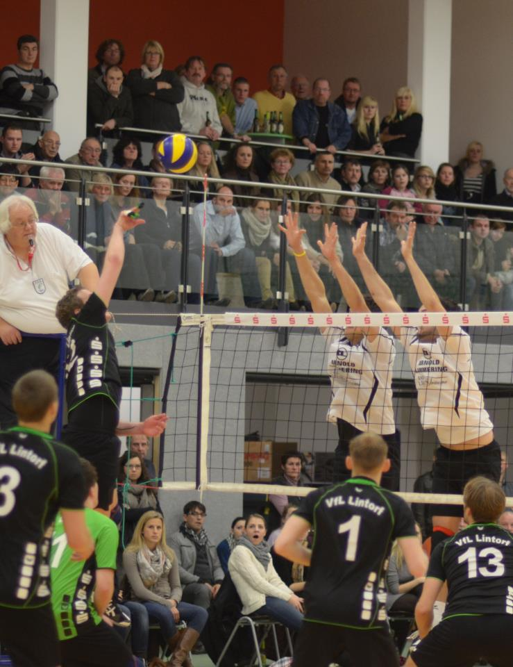 #30 Manusharow and #8 Bremmer putting up a block