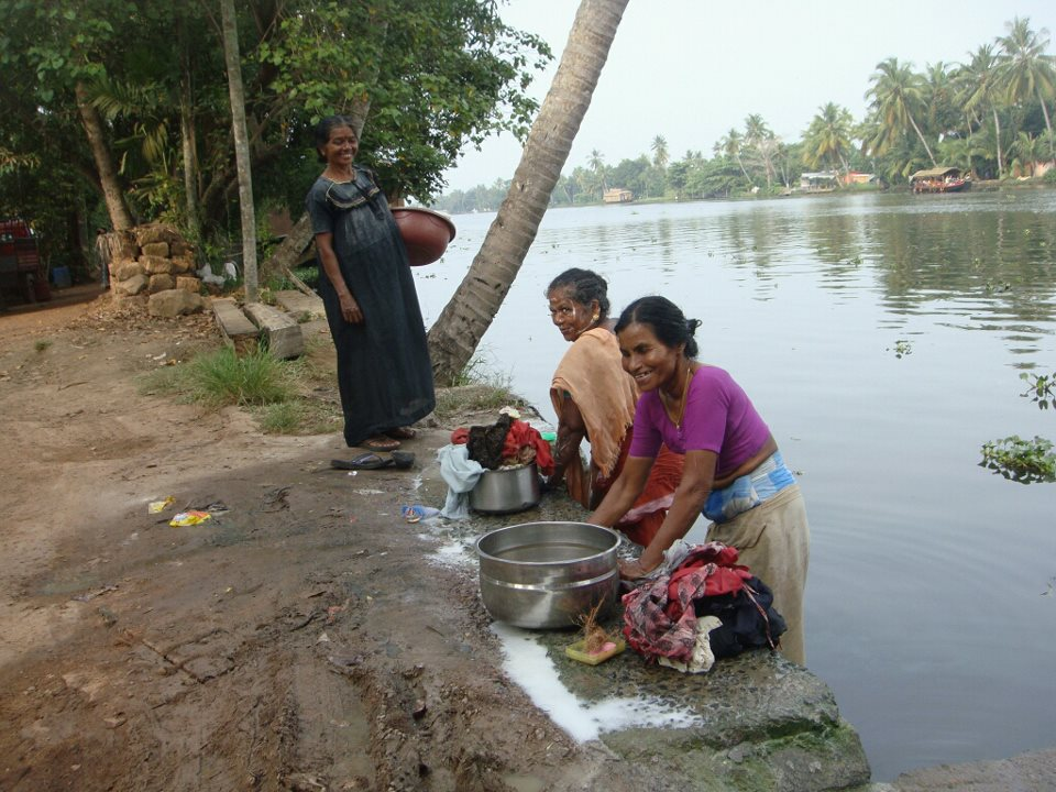 Women doing laundry in Kerala India backwater  cannals