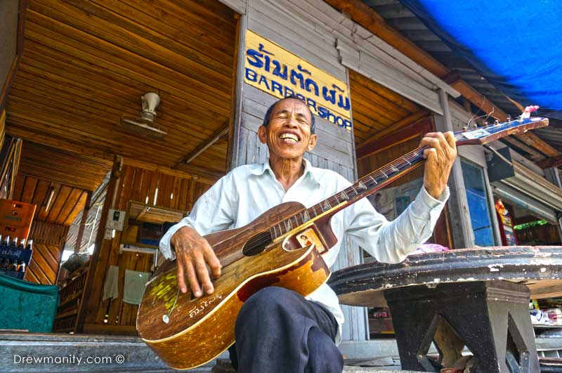signing-barbershop-man-laos-south-east-asia-travel-drewmanity